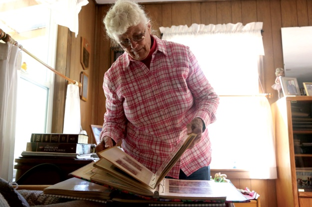 Aggie Wareham, 83, looks through old photo albums, remembering her lifetime spent in Gateway, Colorado.