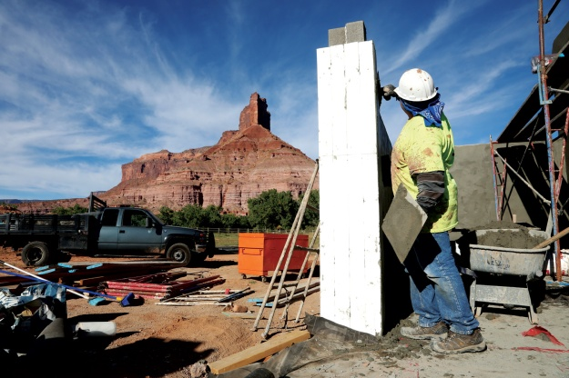 A construction worker from Grand Junction works on infrastructure for employee housing at Gateway Canyons Resort that will include a pool, a gym and more.