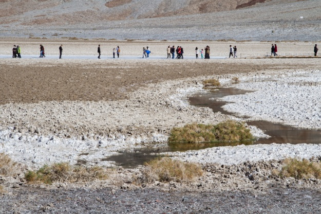 Tourists walk in Badwater in Death Valley National Park.