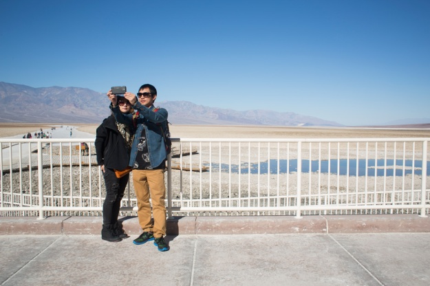 Korean tourists Zo Sun-Hwa and Park Young-Gu take a selfie at the Badwater salt flats in Death Valley National Park.