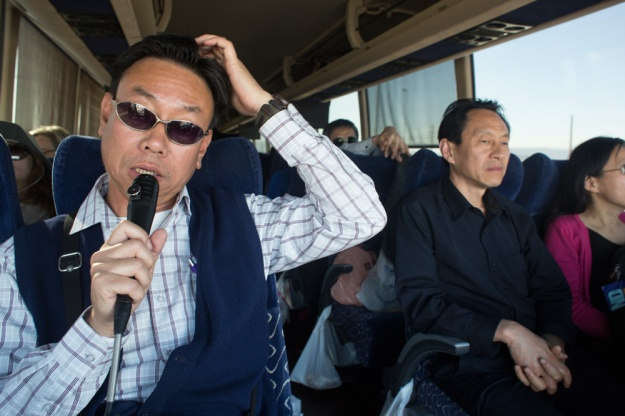 Tour guide for Lassen tours Raymond Tse rattles off the day's itinerary once the bus arrives in Las Vegas after driving from San Fransisco.