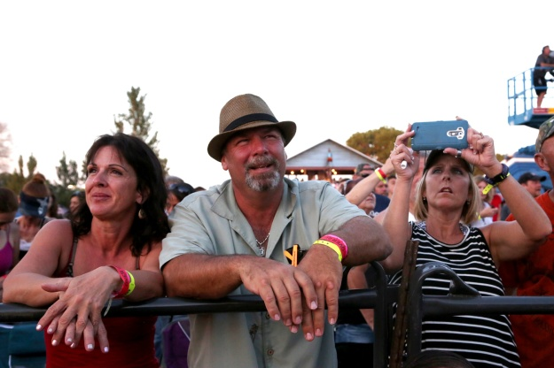 People enjoy and record videos of the music at Bands in the Backyard on June 19, 2015.