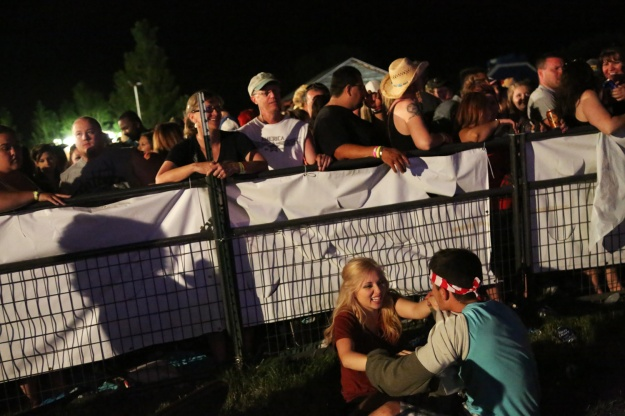 Hannah Duran and Tyler Moltrer play fight during Toby Keith's set at Bands in the Backyard on June 19, 2015.